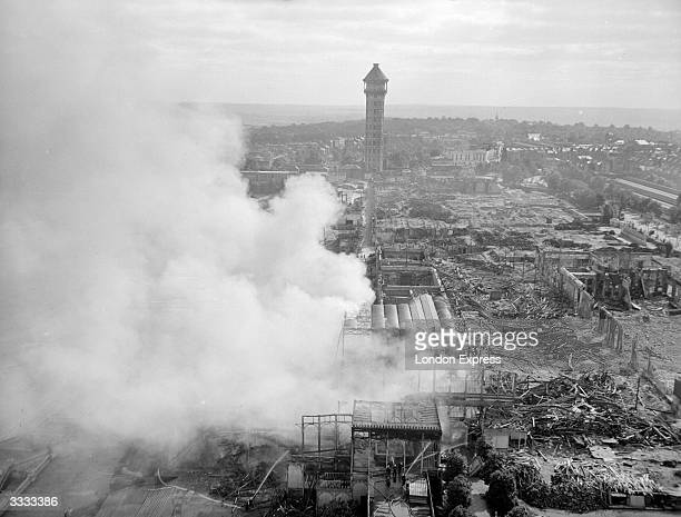 Smoke billowing from the ruins of the fire which destroyed the Crystal Palace exhibition hall in Sydenham South London
