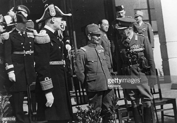 British Admiral Sir Charles Little and Major General A P D Telfer Smollett both in ceremonial uniform meet General Iwane Matsui Commander of the...