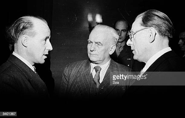 John Hynd , British minister for the civil administration of the British zone in Germany confers with German politician and chairman of the SED , the...