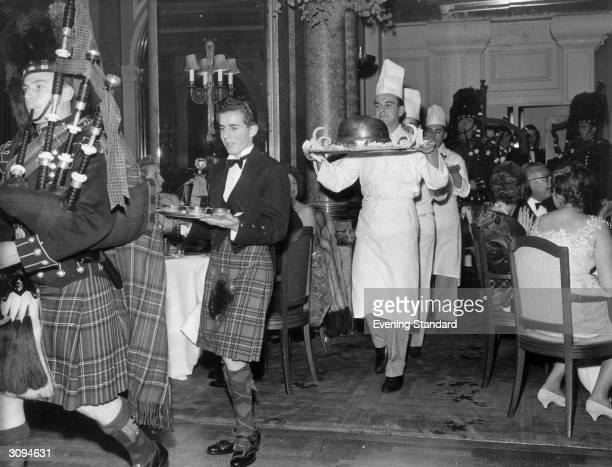 Piping in the haggis in the restaurant at the Savoy Hotel LondonThe haggis born by a chef is preceded by a piper and the whisky It is usually eaten...