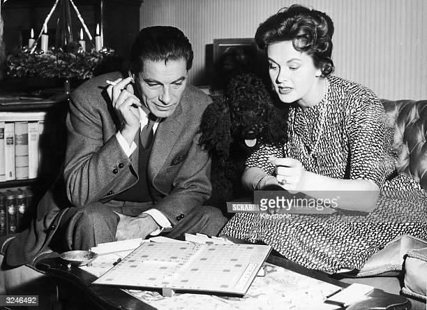 Rudolf Prack and Marianne Wischmann playing Scrabble shortly after its introduction to Germany in time for the Christmas market Their poodle Pinscho...
