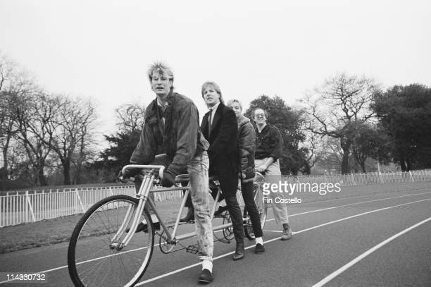 British rock band Any Trouble posed on a tandem bicycle in Battersea Park London in December 1983 The group features Clive Gregson on guitar and Phil...