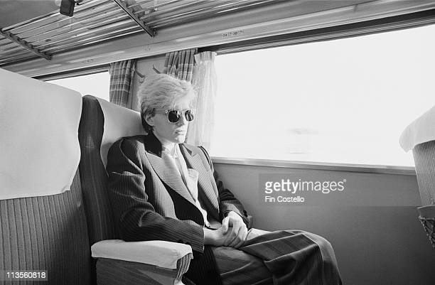 David Sylvian from the English band Japan relaxes on a train in Japan during their final tour in December 1982