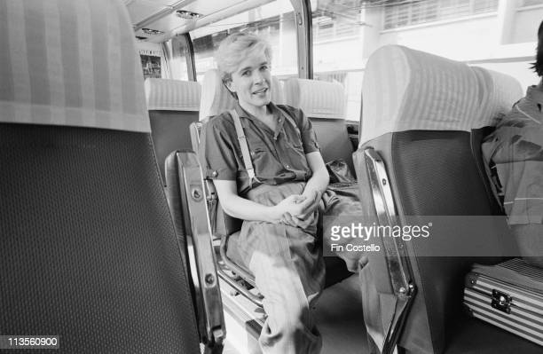 David Sylvian from the English band Japan relaxes on a coach in Japan during their final tour in December 1982