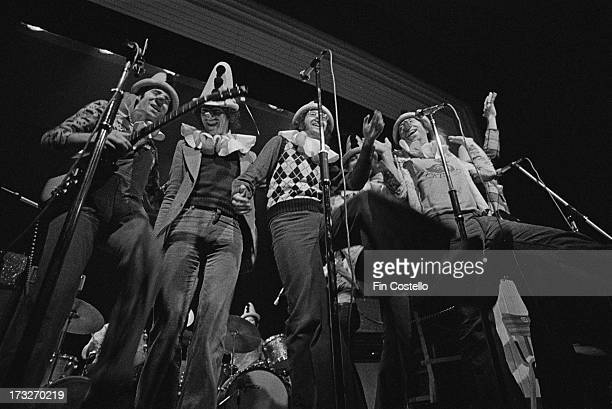 English pop poetry and comedy group Grimms perform live on stage at Kingston Polytechnic in Surrey England in December 1973 Neil Innes is far left...