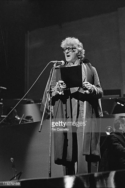 John Pertwee performs live on stage at the Rainbow Theatre in Finsbury Park London during a performance of the rock opera 'Tommy' by The Who in...