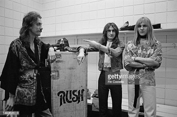 Neil Peart Geddy Lee and Alex Lifeson from Canadian group Rush pose next to a flight case backstage in Springfield Massachusetts 9th December 1976...