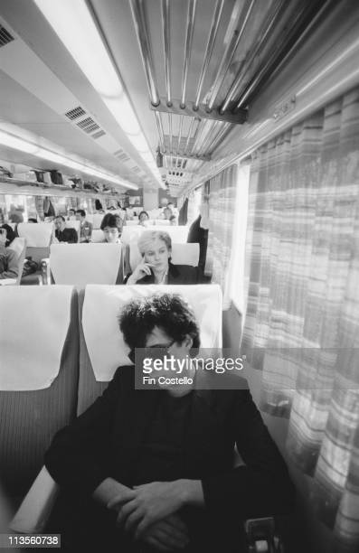 Richard Barbieri and David Sylvian from English rock band Japan relax on a train in Japan during their final tour in December 1982