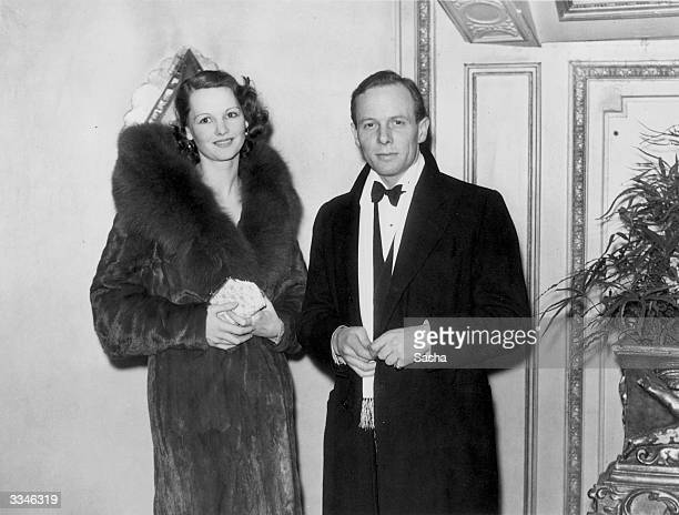 British film actress Elizabeth Allan and her husband W J O'Bryen at the first night of 'Doctor's Orders' at the Globe Theatre London