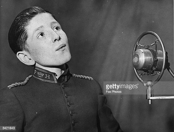 Reginald Briggs a frecklefaced page boy whistling into a microphone