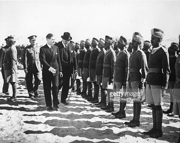 Dominions Secretary Anthony Eden inspecting Indian troops at a camp near the Pyramids during his visit to Egypt