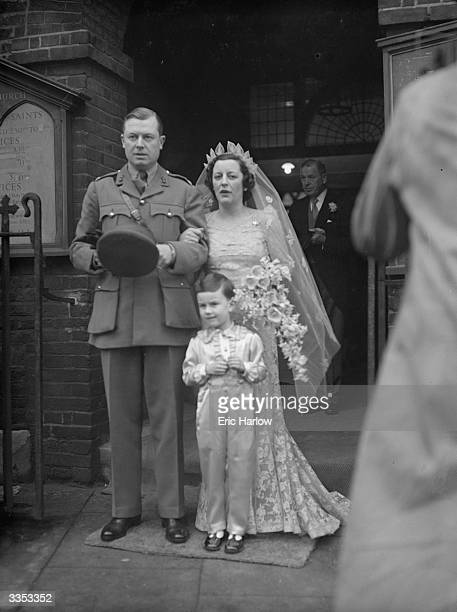 Bride Esme Yarrow and groom Major John Hill of the Honourable Artillery Company leaving Chelsea Old Church after their wedding