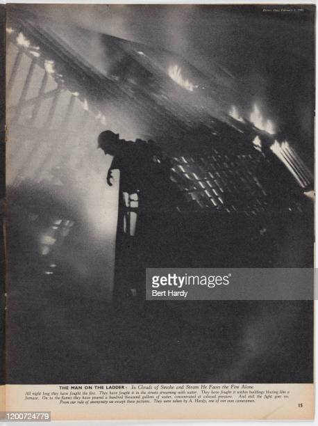London firefighters tackle a blaze during the Blitz Original Publication Picture Post 587 Firefighters pub 1st february 1941 Volume 10 Number 5 Page...