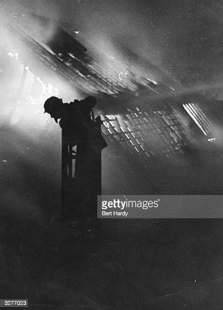 London firefighters tackle a blaze during the Blitz Original Publication Picture Post 587 Firefighters pub 1941