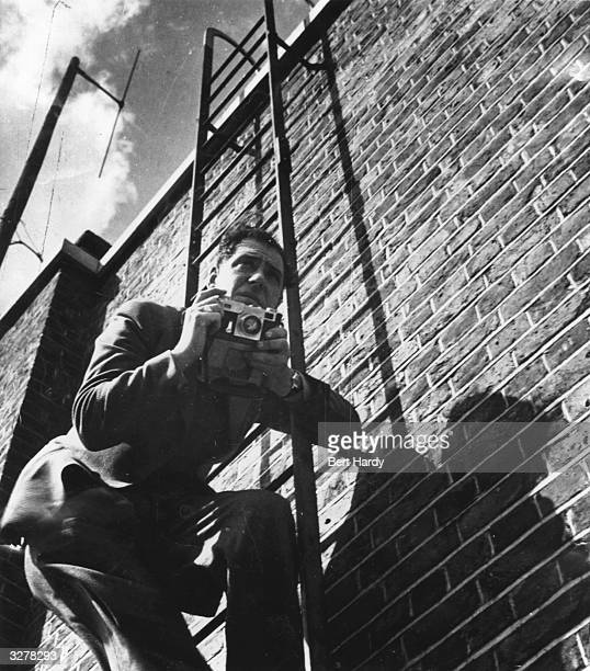 Picture Post photographer, Bert Hardy, in action. Original Publication: Picture Post - 587 - Firefighters - pub. 1941
