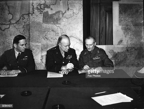 From left to right Air Chief Marshal Sir Arthur W Tedder General Dwight D Eisenhower and General Sir Bernard L Montgomery Supreme Command of the...