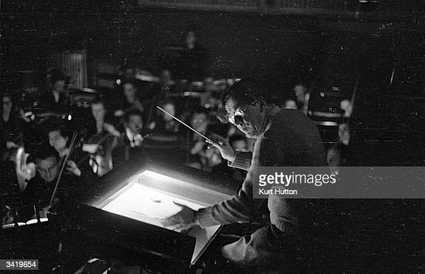 Conductor and composer Karl Rankl rehearsing with his orchestra of eighty at Covent Garden London Original Publication Picture Post 4316 An Opera Is...