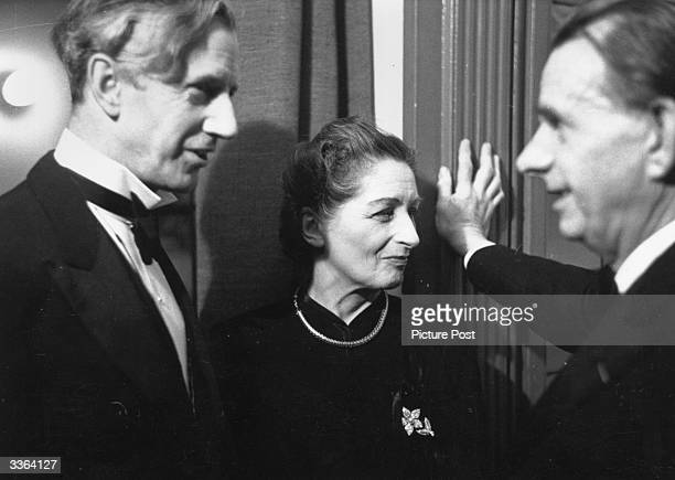 English novelist and autobiographer Vera Mary Brittain and her husband George Catlin talk to the secretary of the PEN Club Herman Ould. They are...