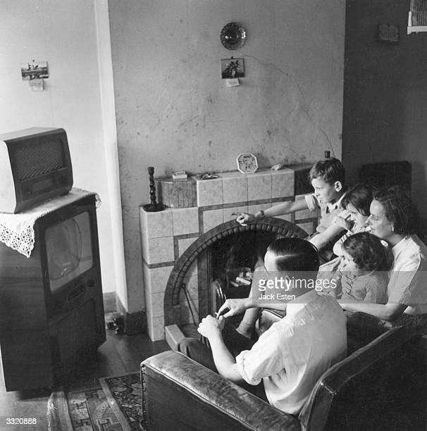 A British family of five watch television Original Publication Picture Post 8809 Car Redundancy unpub