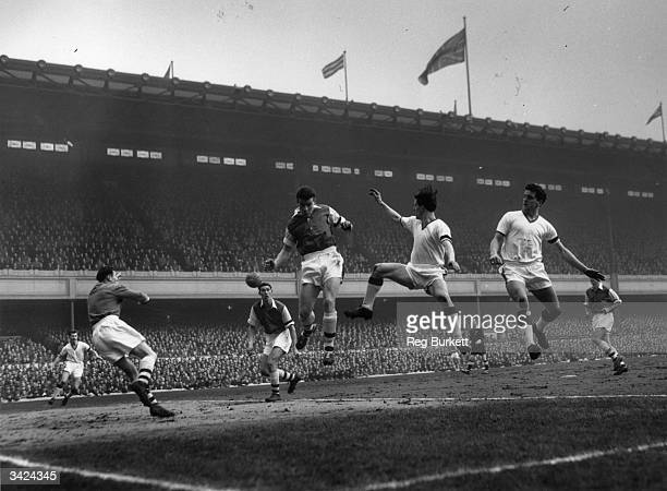 Three players leap together during the match between Arsenal and Manchester United at Highbury Fotheringham of Arsenal looks on at team mate Evans...