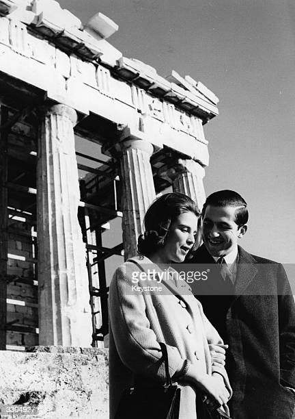 King Constantine II of the Hellenes and his fiancee Queen AnneMarie of the Hellenes beside the Parthenon on the Acropolis Athens