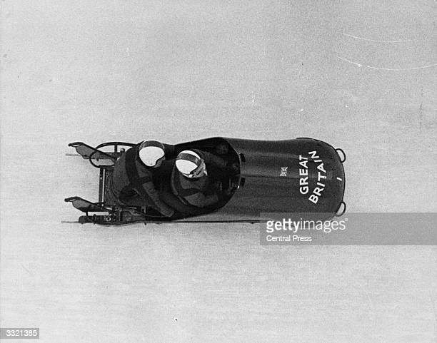 Britain's twoman bobsleigh team driver Tony Nash and brakeman Robin Dixon speeding down the bobrun on their way to winning at the 1964 Winter...