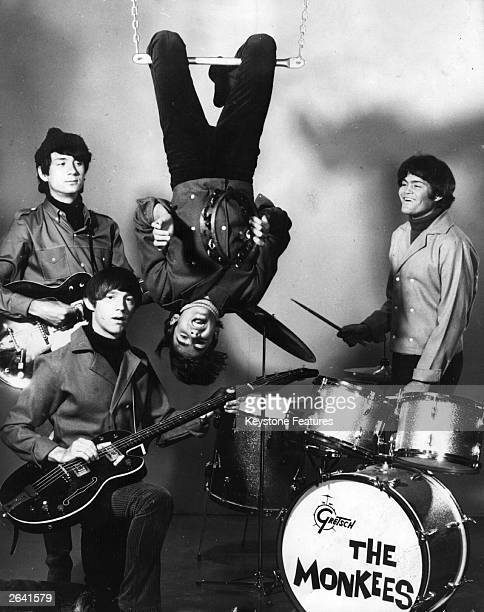 American sixties pop group The Monkees, who were formed for a television show and had no previous musical experience. Hanging from the trapeze is...
