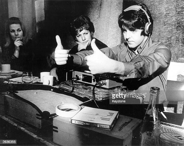 Beatle Paul McCartney gives the thumbs up during production of the new Beatles film a feature length cartoon called 'Yellow Submarine'