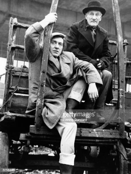 Harry H Corbett and Wilfrid Brambell stars of the popular TV series 'Steptoe and Son' sitting on their cart