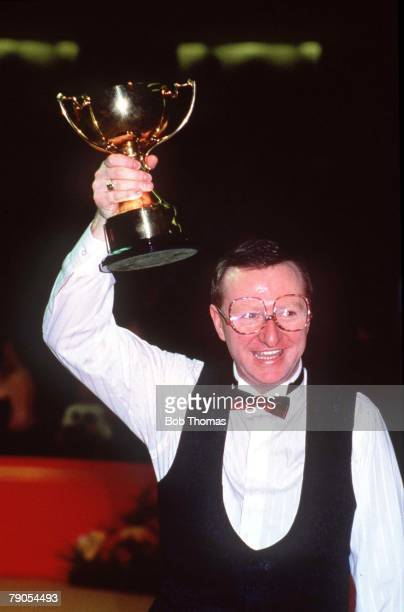 1st February Benson and Hedges Masters Snooker Wembley Northern Ireland's Dennis Taylor holds aloft the Benson and Hedges Masters trophy after...
