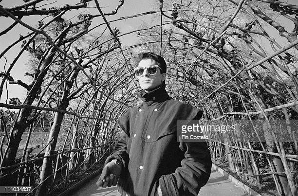 Mick Karn from Japan posed in an avenue of trees in Hyde Park London in February 1983