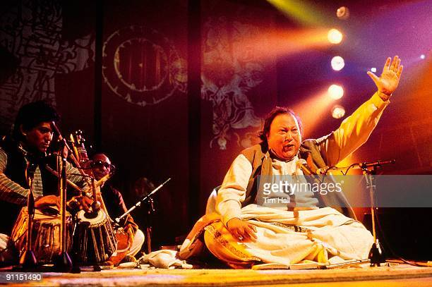 Pakistani musician Nusrat Fateh Ali Khan performs live on stage on the TV show 'Big World Cafe' in February 1989