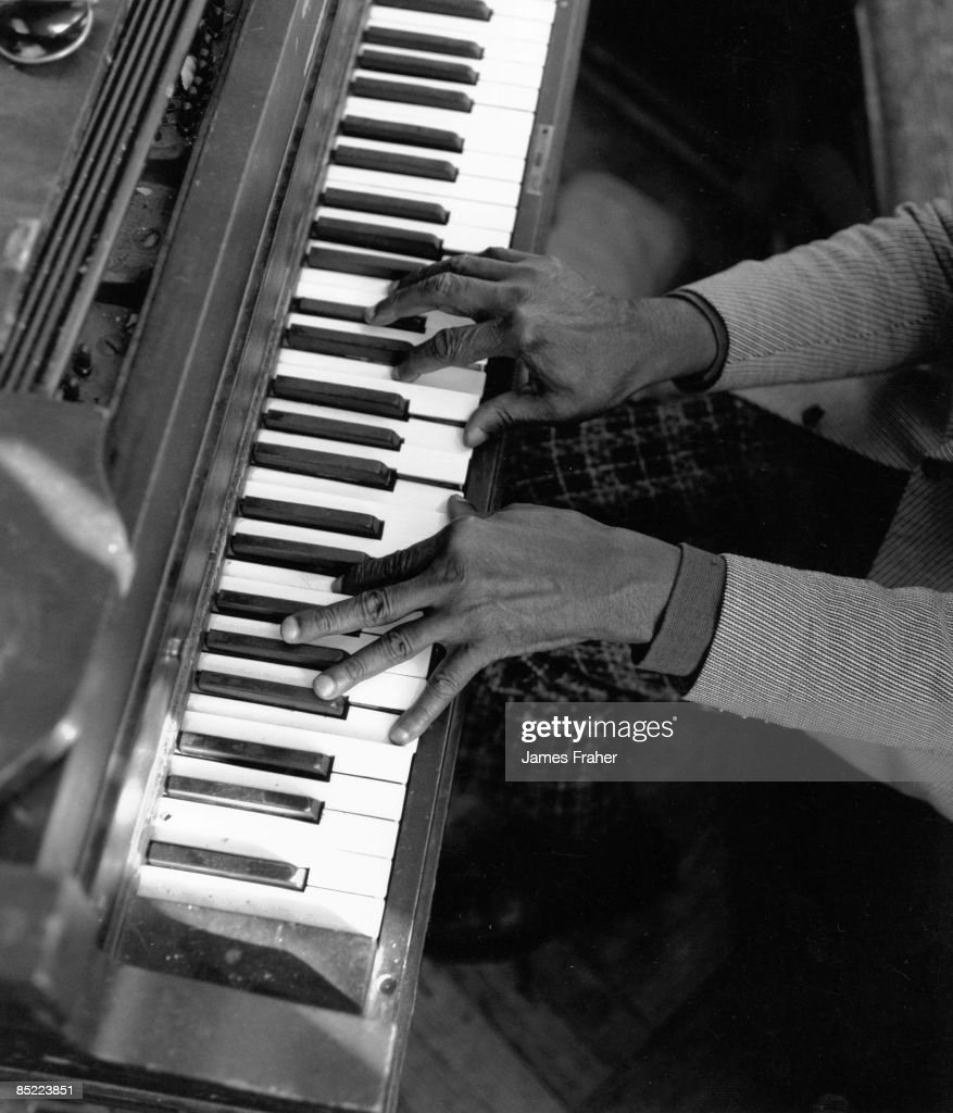 Photo of PIANO and BLUES. Blues pianist performs live on stage in Chicago, Illinois, USA in February 1987.