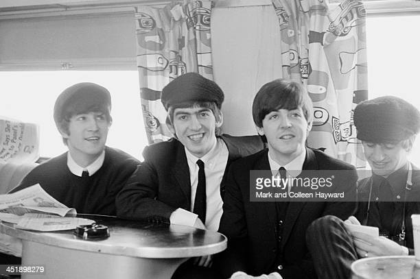 The Beatles posed on a train to Washington during their tour of the USA in February 1964 Left to right John Lennon George Harrison Paul McCartney and...