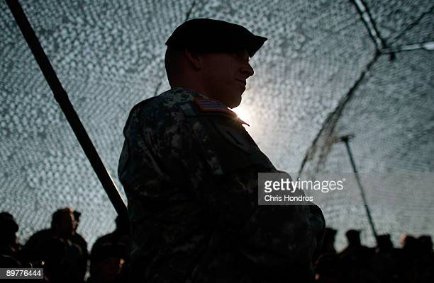 A 1st Infantry Division soldier watches a brigade prepare for another tour of duty in Iraq August 13 2009 at Fort Riley Kansas The Army now requires...