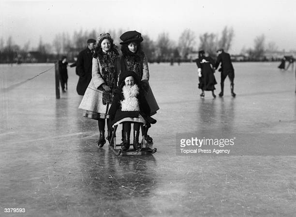 Children enjoying themselves on the ice at Littleport, near Ely.