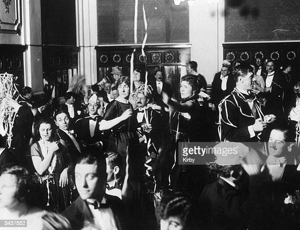 Revellers celebrate the New Year during a party at the Hotel Victoria in London