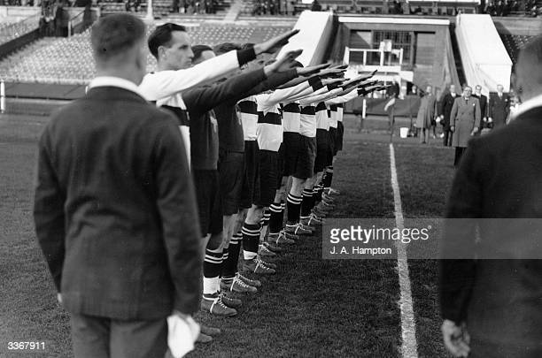 The players of the German Universities team give the Nazi salute during their national anthem before playing a match against Britain at Wembley...