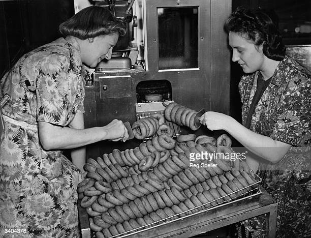 Salvation Army canteen workers in Brighton operating a doughnut machine flown in from Canada to satisfy Canadian troops appetites for donuts