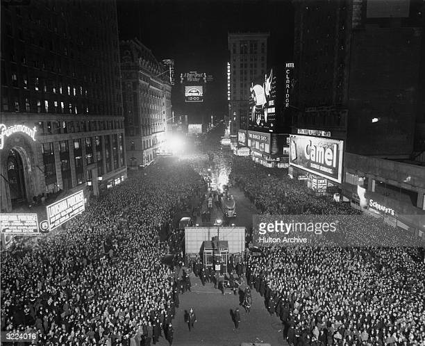 Highangle view of crowds gathering at midnight in Times Square for the ball dropping on New Year's Eve New York City