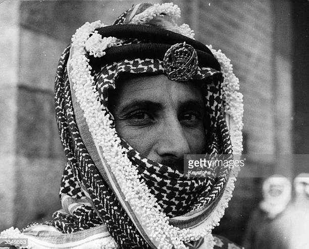 An Arab man, well covered by his head dress, who is a Commander of the Jordan Army on guard at Damascus gate overlooking Israeli territory.