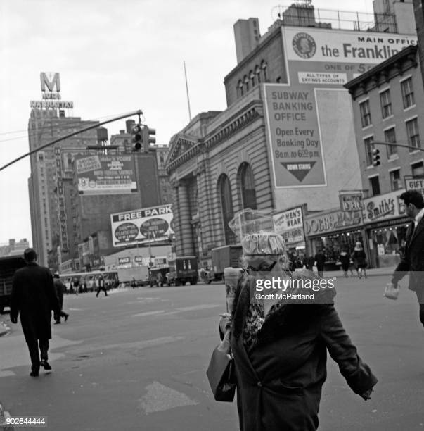 Pedestrians cross Seventh avenue in the heart of Times Square New York