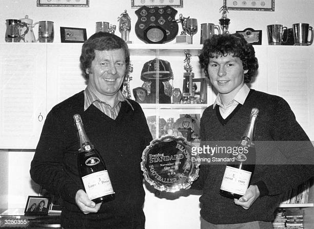 Clive Allen, the Evening Standard footballer of the month, shows off the trophy and champagne at his Hornchurch house, with his dad, Les.