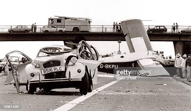 A Citroen 2CV is crushed as a plane falls onto the M62 motorway by the side of Barton Aerodrome Eccles Greater Manchester 1988