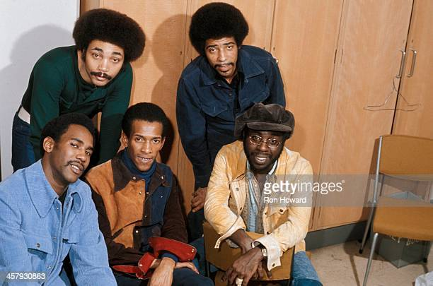 American soul singer Curtis Mayfield posed on bottom right with his backing group backstage at BBC TV's Top Of The Pops in 1971
