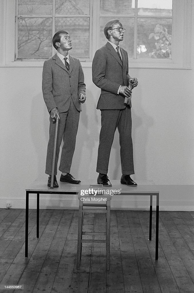 Artists Gilbert Proesch (left) and George Passmore, who work together as Gilbert and George perform their piece 'Underneath The Arches/The Singing Sculpture' at the Nigel Greenwood Gallery at 60 Glebe Place, Chelsea, London in 1970.