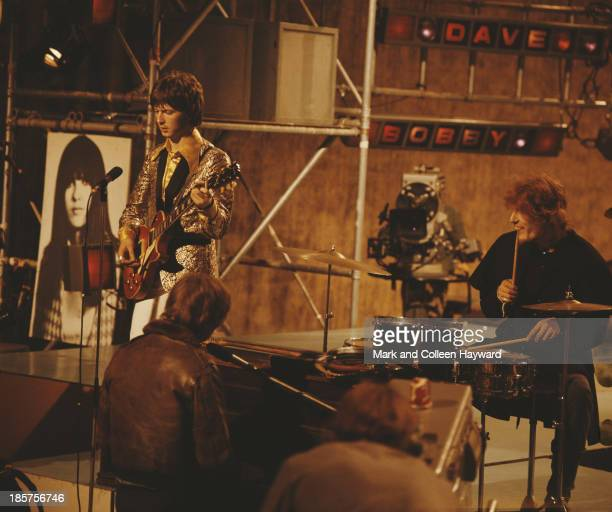 British rock group Cream perform on the TV show 'Ready Steady Go!' in London in 1966. Left to right: Guitarist Eric Clapton, bass player Jack Bruce...