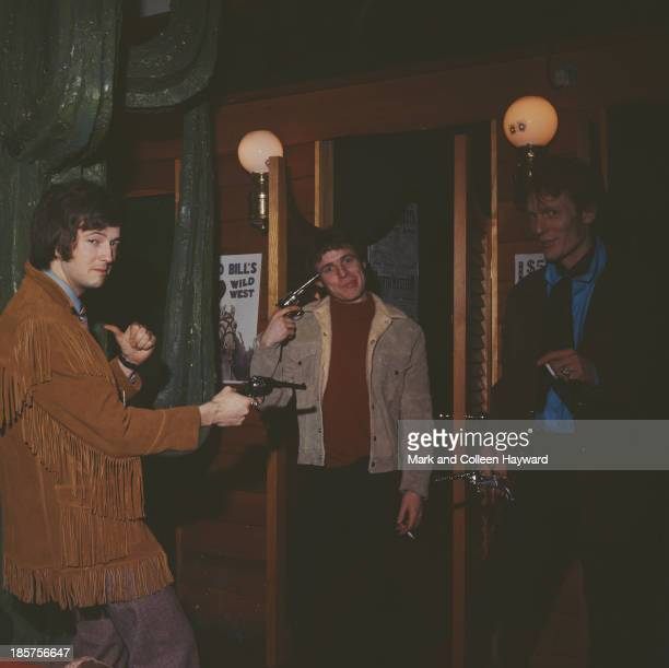 British rock group Cream posed holding replica pistols in a London clothes shop in 1966 Left to right Guitarist Eric Clapton bass player Jack Bruce...