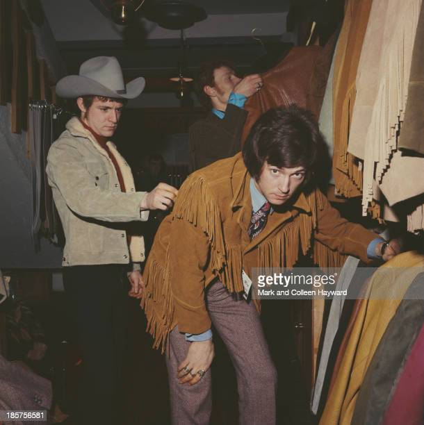 British rock group Cream posed in a London clothes shop in 1966 Left to right Bass player Jack Bruce wearing stetson drummer Ginger Baker and...
