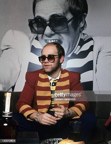 Elton John posed in front of a photograph of himself in Hilversum Holland in 1976